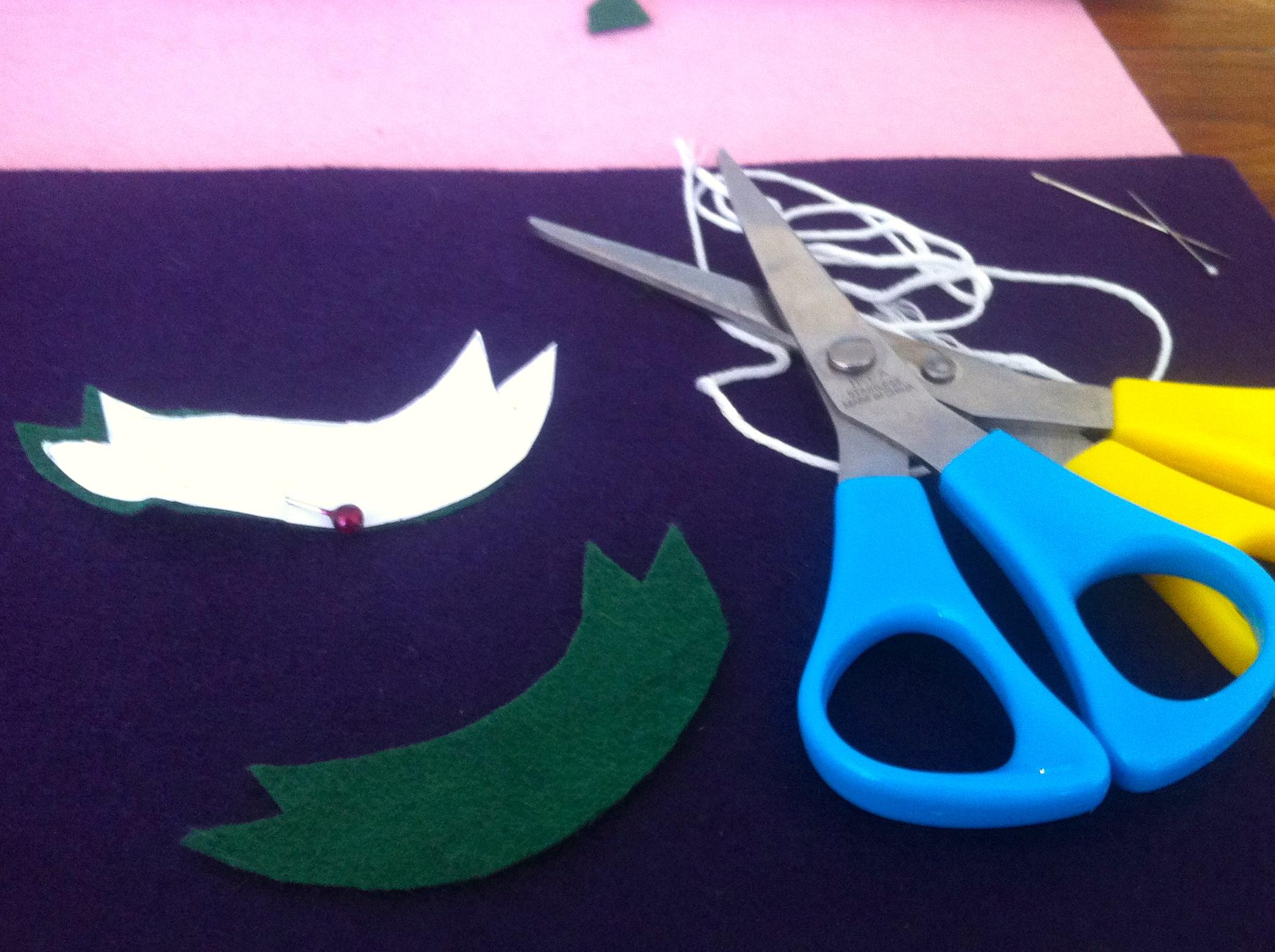 Scissors and half-made felt shapes.