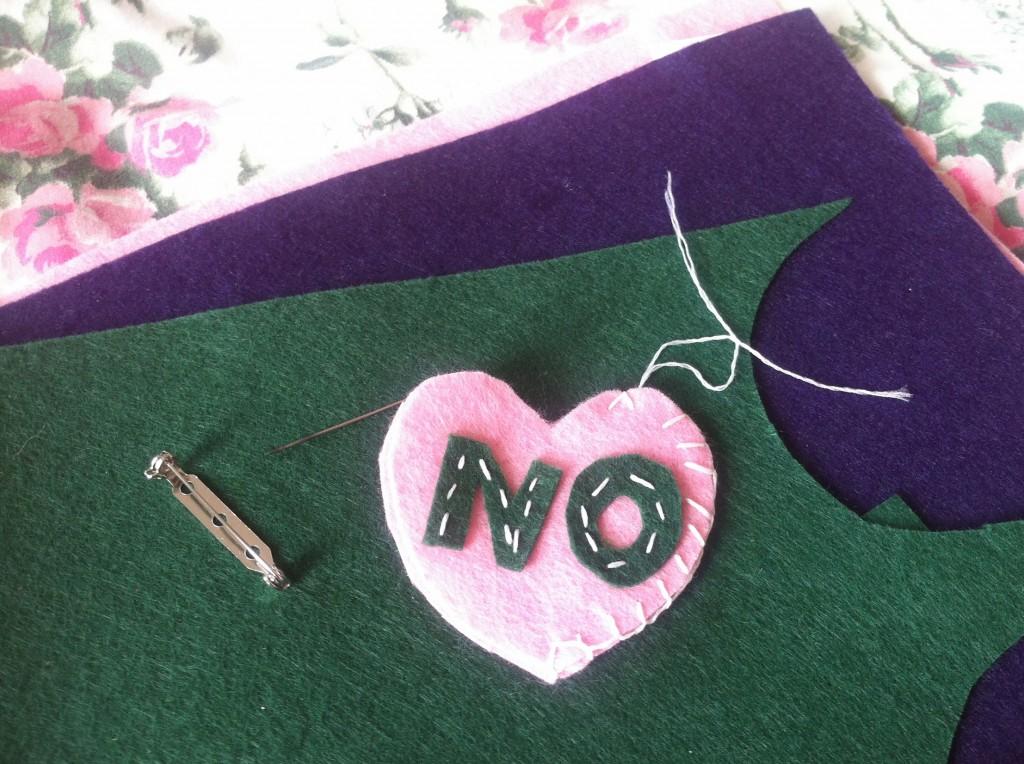 Heart shaped NO brooch.