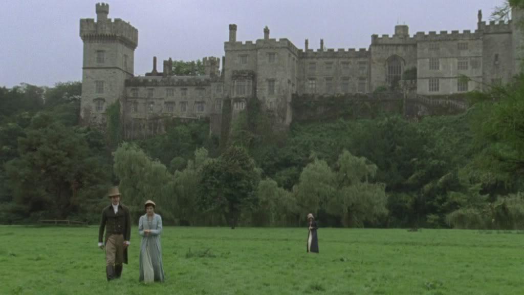 Walking in front of a castle.